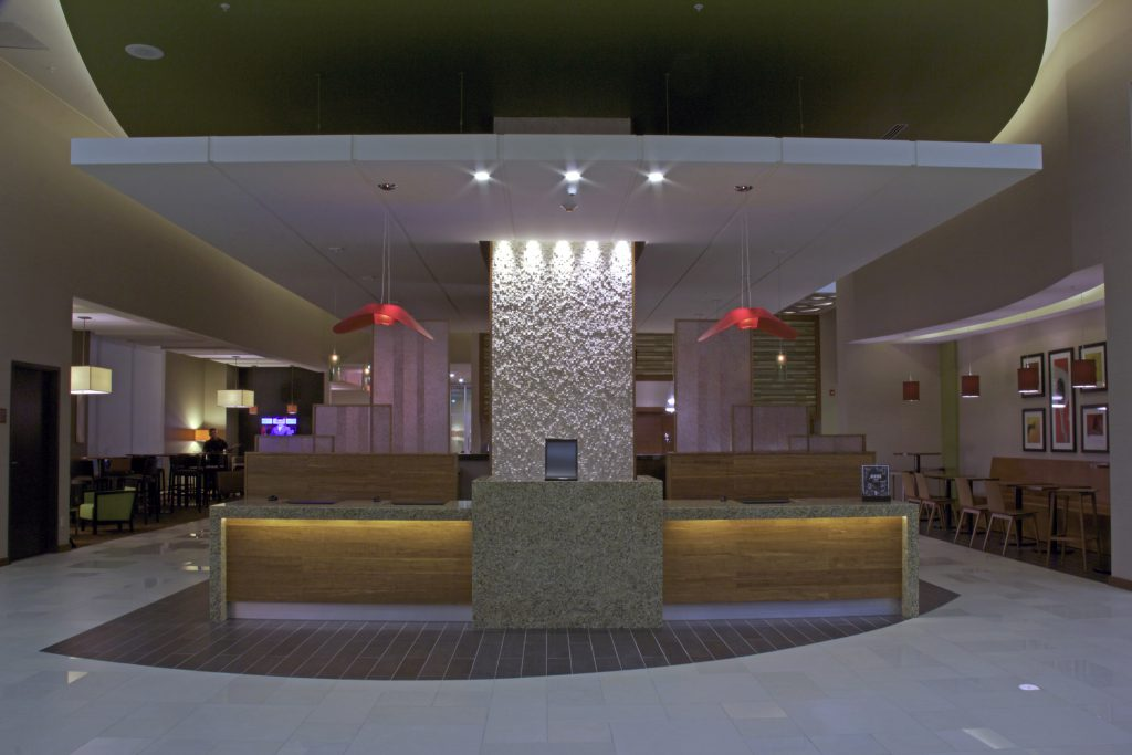 Low angle shot of Hyatt Place lobby in dim light.
