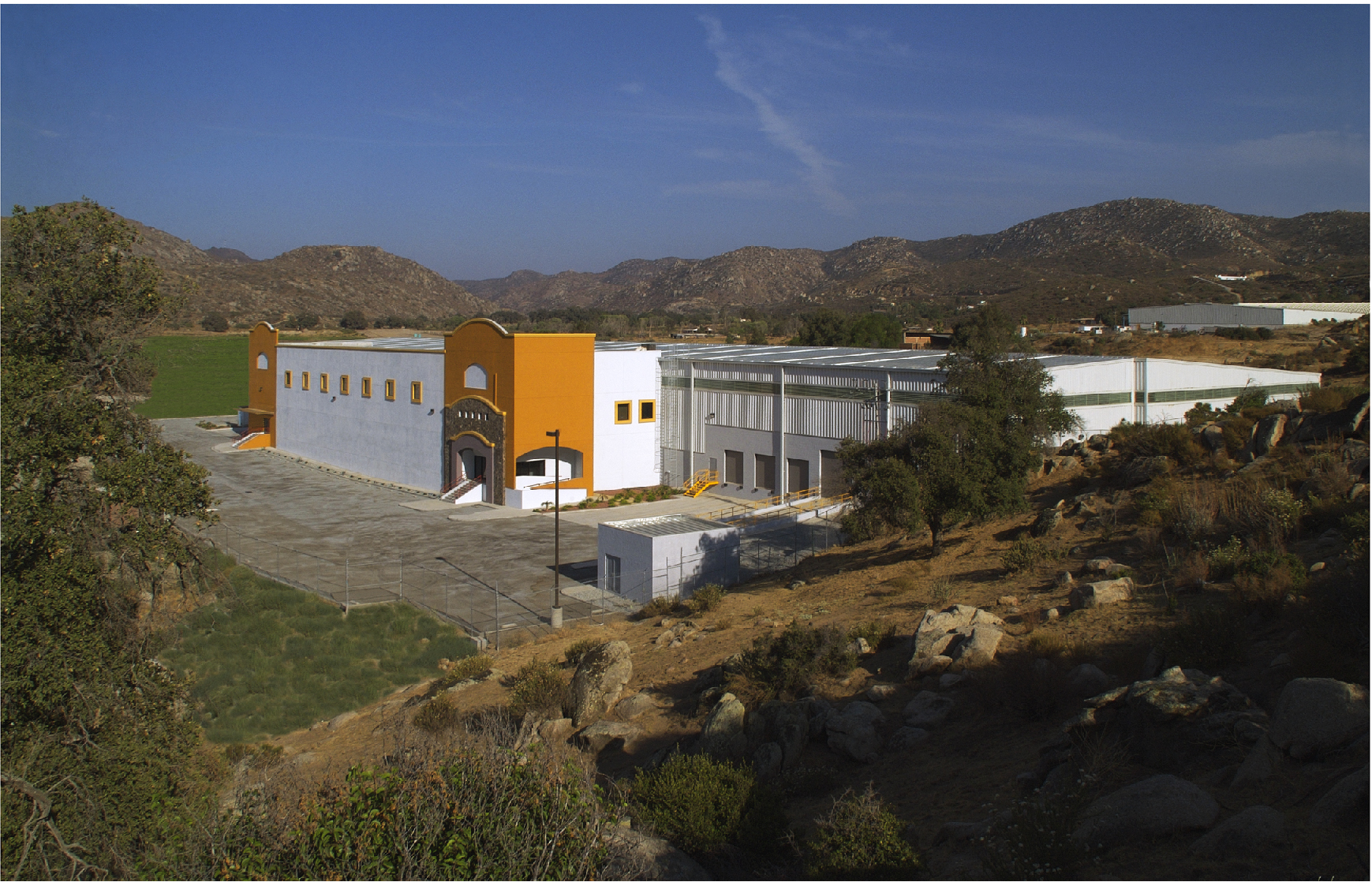 Mid shot of ASI Specialities industrial facility in Tecate, Baja California.