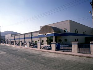 Eye level shot of Gumsung Plastics industrial facility in Tijuana, Baja California.
