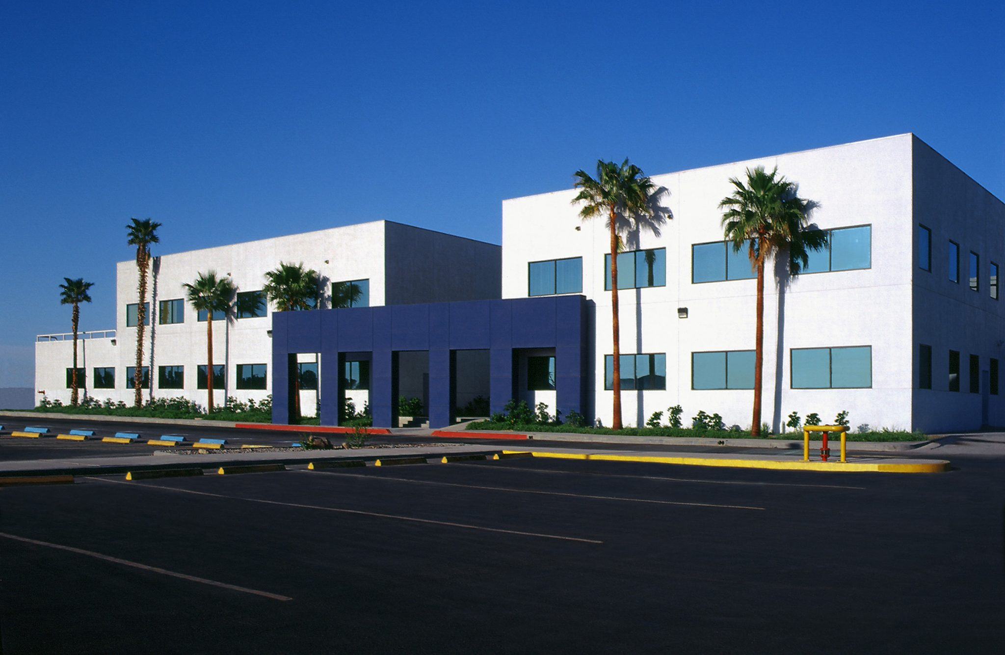 Eye level shot of Triumph Group industrial building in Mexicali, Baja California