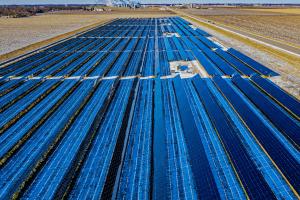 Solar farm in grass field.