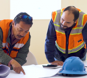 Lean Construction Certified Engineers reviewing projects.